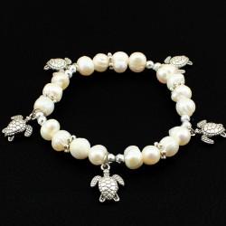Pulsera de perla con abalorios de tortugas