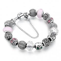 Pulsera con abalorios de plata tibetana y cristal Murano rosa y blanco