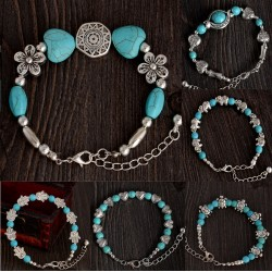 Turquoise and Tibetan silver bracelet with simbolic pendants