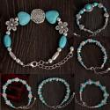 Turquoise and Tibetan silver bracelet with simbolic pendants