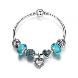 Pulsera rígida con charms cristales azules y colgante corazón
